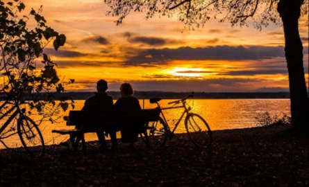 Couple on a bench watching sunset